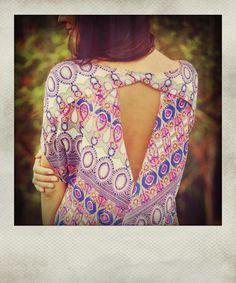 stunning open-back blouse.