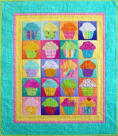 My mom is making this quilt for baby Glory's nursery.  Her theme is cupcakes!!