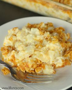 Funeral Potatoes      2 packages Frozen Hash Brown Potatoes 12 oz. (Southern Style)     2 cups sour cream     1 can cream of chicken soup     1/2 cup butter melted     1 tsp. salt     1 tsp. minced onion or onion powder optional     2 cups shredded cheddar cheese     2 cups Corn Flakes, crusjed Mixed with 1/2 cup melted butter
