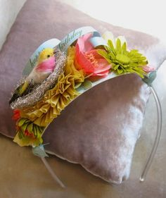 Denise Sharp Birthday Headband.  LOVE  a little too much, but only with flowers...could work for me! (even though i love the lil' birdie in her nest!!