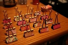 What a great idea!  Place card holders.