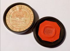 An antique red wax seal which is cracked on the thin edges.. it has 2 Latin - French wording lines which means WHAT I LIKE ABOUT YOU....the seal engravers lable under the lid... LONGMAN & STRONGI'TH'ARM ENGRAVERS TO HIS MAJESTY WATERLOO PLACE LONDON