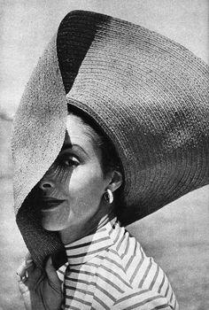 Model wearing a wide brimmed hat, 1950s.