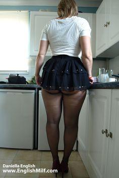 Curvy big ass big butt British English milf wife in arse revealing short mini skirt, black pantyhose tights and high heels. Sexy nylon booty flash women in pantyhose.