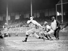 An unknown Boston Red Sox batter pops one up against the Boston Braves in the annual City Series pre-season exhibition game at Braves Field in 1937.