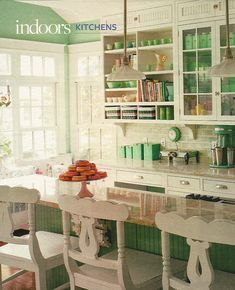 Oh my goodness!  Those gorgeous green walls could make me change my mind about a yellow kitchen.  Love that green with the white.  Add in some pink floral plates and such, and it would be perfect!