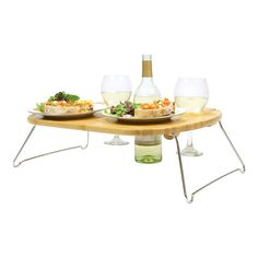 Folding bamboo tray with holders for a wine bottle and 2 glasses.