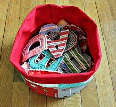 a bucket of letters made from scrap fabrics.