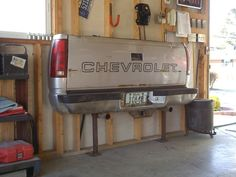 Tail Gate Couch  perfect for in the garage or the barn!  Nothing more fun than sitting on the tail gate