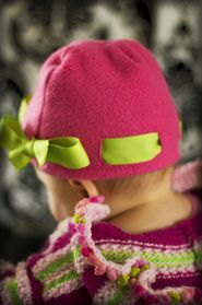 Fleece hat with ribbon.  Cute!