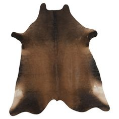 Luxurious on its own or layered atop a complementing rug, this hand-woven cowhide design brings a touch of rustic glamour to your decor.