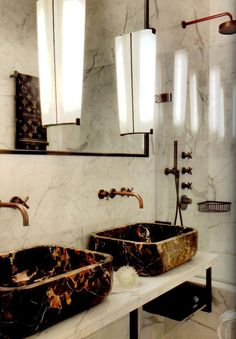What an amazing display of marble. The marble sinks are designed by Colin Cuarto and are the perfect complement to the fixtures. Check out those sconces, reclaimed from an Italian Hotel. Molto bello!