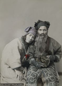 Ainu husband and wife.  Hokkaido, northern Japan.  About 1900.  Hand-colored.  MIA