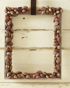 Mixed-nut wreath: Perfect for Thanksgiving. Here's how: http://www.midwestliving.com/holidays/thanksgiving/easy-ideas-for-thanksgiving-decorating/?page=24,0