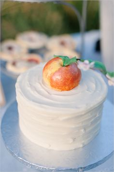 wedding cake with a peach topper or decorations..