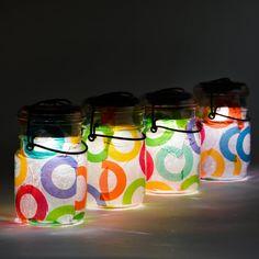 mason jars, tissue paper, modge podge and solar lights
