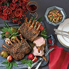 Sage-Crusted Pork Racks with Pear Chutney | These mouthwatering pork racks topped with a spiced Pear Chutney are the perfect main dish for your holiday dinner. Have your butcher French the bones for a more elegant presentation. | SouthernLiving.com