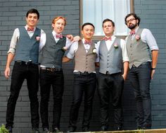 """The males in the wedding party went for a funky look. Angela says """"We were trying to go for a mish mashed trendy look that wasn't too stuffy or hot for a summer January day. The groom and groomsmen all wore tight black jeans, vests and bow ties. The red plaid bow ties were from the Etsy seller """"Sew Fairy Cute""""."""""""