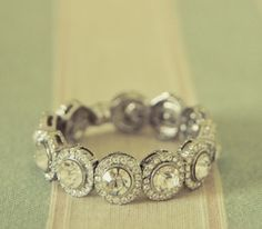 Mix between a band and a traditional engagement ring.