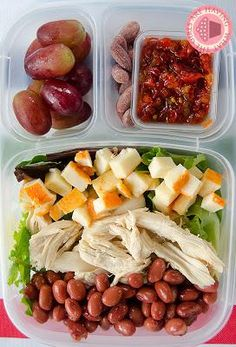 mixed greens with roasted chicken, beans and cheese.  The small container has my crushed red peppers and I also have some raspberries and chocolate chips.