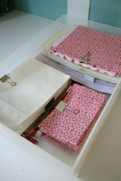 Organizing gift bags. Use binder clips to clip them together by color, size, theme...