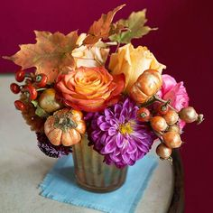 We love this bouquet of Fall Flowers and Vegetables. More #Thanksgiving centerpiece ideas: http://www.bhg.com/thanksgiving/indoor-decorating/centerpiece-and-tabletop-decoration-ideas-fall/