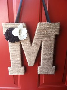 Twine covered letter door hanger with felt flowers