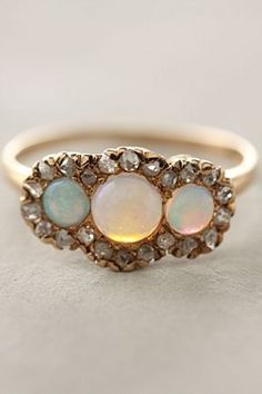 Always loved opals, even though I think they are considered a bit uncool. These are the types i would like to have added to my wedding band eventually.