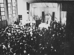 A large crowd attends a memorial service for the first anniversary of Kristallnacht in an auditorium in Shanghai. November 12, 1939.