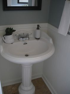 The wall color is Martha Stewart's, Winter's Day matched to Behr paint. Bead-board wall paper used under chair rail.