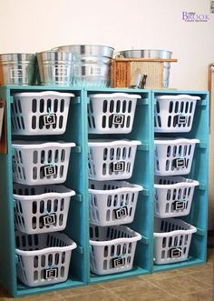 Laundry Basket Storage Idea. Kids bring laundry baskets to laundry room or they do it themselves! :)
