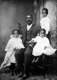 African American father and three children