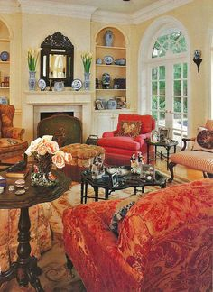 Sumptuous yellow and red traditional living room.