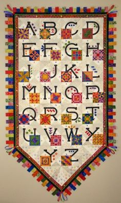 quiltsjanet stone, alphabet quilt, stone quilt, ribbon border, quilt blocks