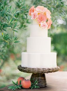 interesting! wicker cake stand for a rustic outdoor wedding