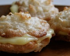 Coconut Macaroons With Meyer Lemon Curd. Yum. I must say these do look tempting.