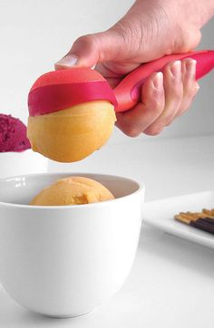 Easy release ice cream scoop // a gentle press on the back of the non-stick spoon releases a perfect ball of icecream #product_design