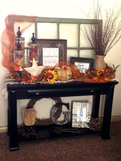 Fall Decorating, sofa table/entryway..i love this. the window and the decoration underneath the table especially.