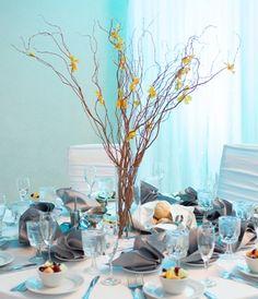Tree branch and flower wedding centerpiece.