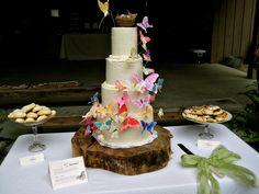 DIY Wedding Cake advice + butterflies in action (on wood pedestal)