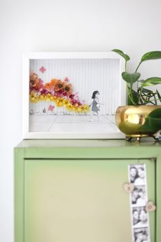 Turn a simple photo into a work of art with artificial flowers and hot glue!