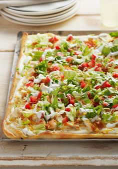 Chicken Club Pizza — Chicken, bacon, lettuce and tomato come together for a deli fave translated into a melty, hot pizza. Get all the flavors of a delicious club sandwich in every bite.