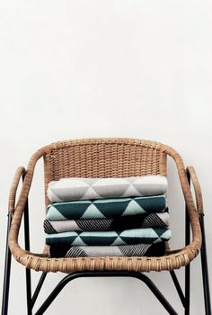 blankets on a wicker chair