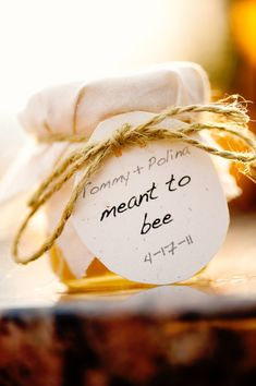 Cutest favors! Honey jars with an adorable sign :)
