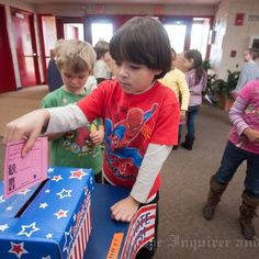 Casting ballots in a mock election at Nantucket Elementary School ...