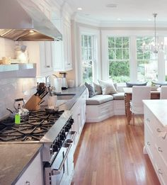 White Cabinets are a must - window seat is cute.