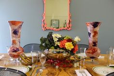 This festive Fall table is set with gorgeous Italian glass vases from HomeGoods. The jewel tones set the color palette for this lovely space. #sponsored