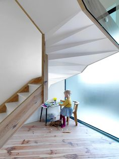 Staircase inside a pale-brick extension added to a north London home.