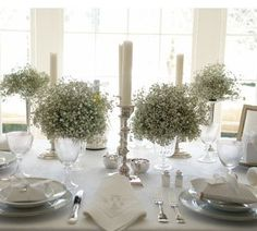 Baby's breath and candle centerpieces