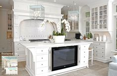 White coastal kitchen tv in island